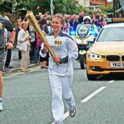 Anna Hulme runs with Olympic Torch