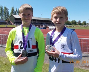 Owen Southern and Kai Finch first and second in the Merseyside Under13s high jump clearing 1.35m
