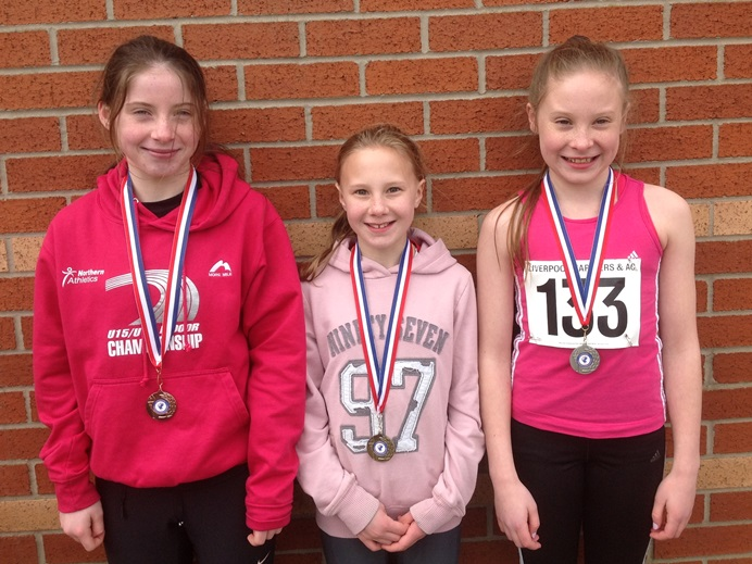 Lauren Ramsey, Scarlet Whitfield, Sadie McNulty proudly show off their medals won at Wavertree
