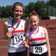 Bethany Milton & Sadie McNulty show off their medals won at Merseyside AA T&F Championships