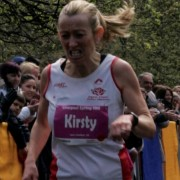 Kirsty Longley gritting her teeth as she comes home to win the Spring 10k at Sefton Park