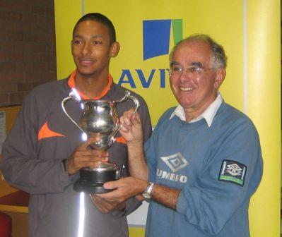 MMike receives the Blaire trophy from former coach John Bradshaw for the outstanding performance by a Merseyside athlete at a National Championship