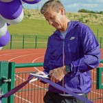 Steve Cram cuts the tape to open the new sports facilities at Edge Hill