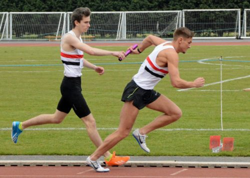Joe Milton (400m)& Luke Edwards taking the baton for the final leg of 400m relay