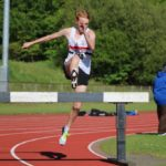 Adam Jones on route to Under 20 steeple chase title