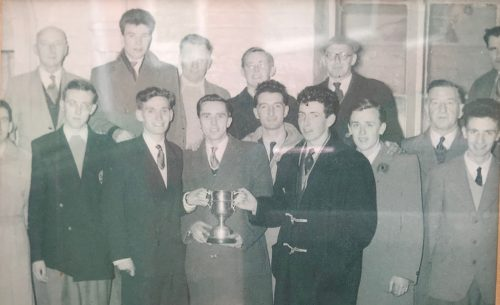 Sefton Harriers 1956 Back row Teddy Rogers, Malcolm?, Bob Mount, Albert Marsden, Andy Byrne, Jack Caldwell (half in photo) Front Row Bert Searle (half in photo)Ken Woolridge, Mike Hoyeland, Chris Marsden, Vin Rogers, Steve Rogers, Brian Fozard, Alf Glaister, Brendan Deary,