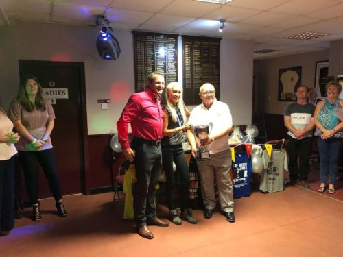 Lisa being presented with her winners cup at the presentation evening.